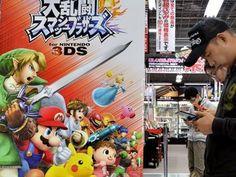 Nintendo slashes profits target