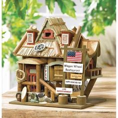 Wagon Wheel Restaurant Birdhouse | Lexi's Kreationz, LLC | http://lexiskreationz.storenvy.com/products/883789-wagon-wheel-restaurant-birdhouse
