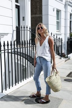 White tank, jeans, sandals and a great pair of sunglasses.