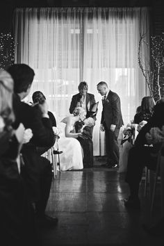 Giving her son a kiss after her husband. Adorable! Photo by Molly. #minneapolisweddingphotographers #weddingceremony