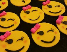 Emoji cupcake toppers. Smiley face with pink bow.