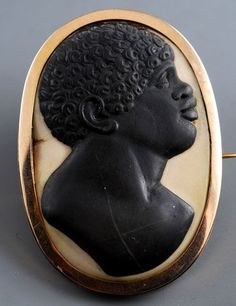 Anonymous Italian Jeweler  Cameo with Bust of a Black Man  Italy (18th Century)  Banded Jasper, Gold setting, 48 x 34 mm.