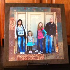 Saw this idea on Pinterest...and decided to try it for myself...turned out amazing!!!!  Used a 18x18 tile from Lowes $6, random scrapbook paper scraps I already had at home, and a 12x12 print of our family picture printed at Wolf Camera $19...mod podge from Hobby Lobby $4 container...lasts a long time!  This is going on top of out fridge.  Fabulous!!
