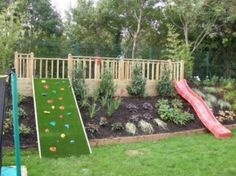 Slide and rock wall built into landscaping