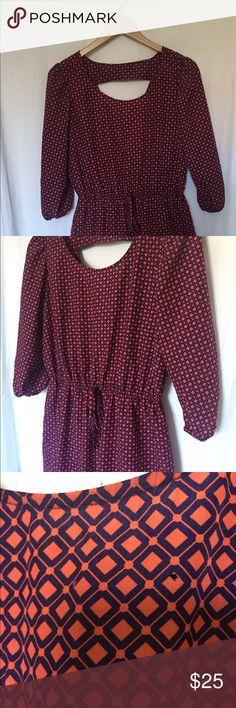 Women's dress for sale! Perfect dress for fall! Dress is casual and fun. U-shaped neckline with elastic waistband at hipline. Back has triangle cut out. There are two tiny, tiny holes on the front side close to the neckline. BeBop Dresses Mini