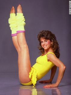 Jane Fonda, fitness advocate and aerobic wear enthusiast, with the number one fashion trend of the the legwarmer. Fashion 60s, Fashion Trends, Fashion Wear, Golf Fashion, 1980s Aerobics, Aerobics Videos, Carolina Herrera, Jane Fonda Workout, Fitness Icon