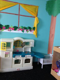 Preschool classroom creative dramatic play dress up house area