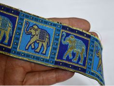 Wholesale Blue Elephant Parade Jacquard Trim Embroidered Sari Ribbon Sewing Supplies Indian Sari trim by 9 yard Elephant Border For Purses You can also purchase from What's App no. Indian Costumes, Elephant Parade, Bridal Clutch, Elephant Pattern, Sewing Accessories, Ribbon Crafts, Metallic Thread, Rock, Band