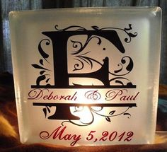 Glass Block with interior lights and ribbon. Choice of painted or custom vinyl wedding or anniversary design.
