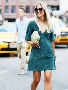 On Charlotte Groeneveld: Zara dress; Celine bag.  A pop of contrasting colors is a great way to put together an interesting look.