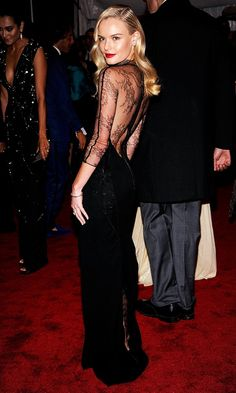 Kate Bosworth channeled Old Hollywood glamour at the 2009 Met Gala in a low-back lace dress, retro waves and red lip