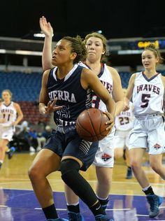Description of . Sierra Canyon's Alexis Griggsby gets behind Justin-Siena under the basket in the CIF-State Division IV Finals, Saturday, Ma...