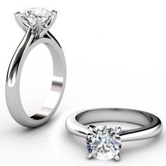 Round brilliant cut diamond ring with a unique swing style center collet