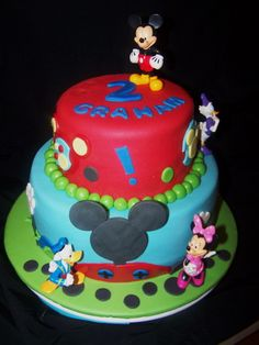 A very colourful two-tiered Mickey mouse cake. Each tier have different colours, a combination of red and blue perfect for a little boy's birthday.