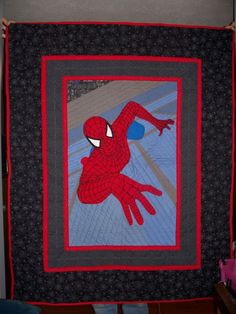 Spiderman quilt I made. All webbing is hand embroidered onto applique then sewn down by hand.