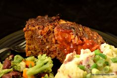 """Bacon Blue Meatloaf Knowing our love of all things bacon a neighbor gifted us with a big bag of already made and crumbled bacon, everything is better with bacon. Louisiana Grills Spicy Sweet Hot Seasoning added just the right amount of """"wow"""" to the flavor of our meatloaf. Patti added blue cheese. Hands down I think this was the best meatloaf I have ever had. The seasoning and blue cheese just """"Off the Hook""""!!!"""