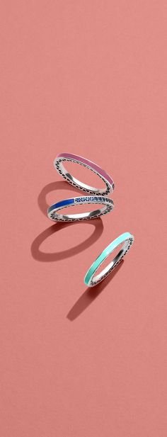 Combine your favourite hues with the Radiant Hearts of PANDORA rings