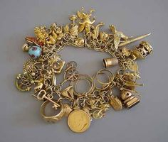 Charm bracelet #amazing #jewelry I've always wanted one just like my Mom had.