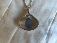 Silver pendant with moon stone(?), Sweden, 1959. By Hedbergs Guld- och Boettverkstad, Stockholm.