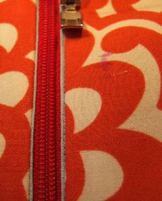 Tutorial for sewing an interior zippered pocket into a bag.