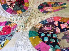 A traditional and bright patchwork i-spy lap quilt made with modern Cotton and Steel designer quilting cottons in a Lots of dots quilt pattern with the kind permission of Green Bee Patterns and machine quilted for durability and then hand quilted with perle cotton to add detailing. A bright and pretty i-spy quilt featuring ponies, mermaids, kittens, princesses and even vintage telephones!  It is a great size to use as a sofa throw on chilly evenings or as a baby or toddler blanket as it…