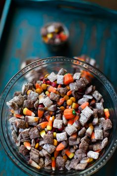 Halloween Puppy Chow - Puppy Chow is a childhood favorite. A few new ingredients, a few twists and turns to the recipe, and puppy chow is now a new halloween/fall favorite recipe.