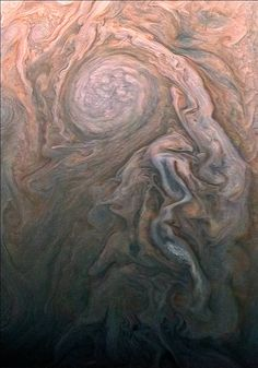 NASA's Juno spacecraft skimmed the upper wisps of Jupiter's atmosphere when JunoCam snapped this image on Feb. 2 at 5:13 a.m. PT (8:13 a.m. ET), from an altitude of about 9,000 miles (14,500 kilometers) above the giant planet's swirling cloudtops.  Streams of clouds spin off a rotating oval-shaped cloud system in the Jovian southern hemisphere. Citizen scientist Roman Tkachenko reconstructed the color and cropped the image to draw viewers' eyes to the storm and the turbulence around it.
