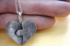 ABSOLUTELY <3 this necklace!!!  It's a puzzle piece of two hearts with the texture of finger prints!!!