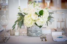 Green and White Centerpiece in a silver mercury container with roses, stock and hydrangea by Soiree Floral - www.soireefloral.com