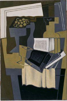 Carafe et livre (Garrafa y libro) 1920 (abril). Óleo sobre lienzo, 81,3 x 54 cm. Museo Reina Sofía. Obra de Juan Gris