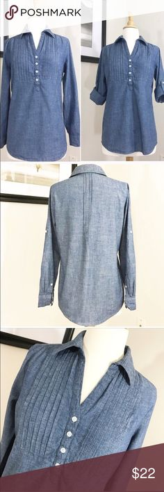 DENIM CHAMBRAY TUNIC BLOUSE DENIM CHAMBRAY SHIRT . Classic style Classic fabric . A long classic tunic top . Perfect over Leegings so cute with boots and leggings . Yet how fun in the warmer months with shorts . A classic style that has year round appeal . Pearlized button front with a pleated yoke . Menswear pleated back . Pearlized buttons on cuffs . Size small Length from back of collar 28 Bust flat is 18 Sleeves 23 . Preloved in excellent condition 💜 Tops Blouses