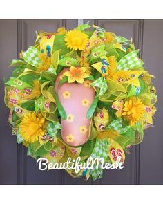 It may be cold now but spring and summer are coming! Green and yellow deco mesh with flip flop patterned ribbon, flowers, and one big flip flop centerpiece! Created by Beautiful Mesh / CraftOutlet.com photo contest