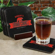 Man Cave Personalized Drink Coaster Set. Your man will growl with delight when he adds these personalized bar coasters to his man-cave area. Our personalized man-cave coaster set comes with four premium hardwood coasters with cork bottoms in a mahogany coaster holder. Each custom man-cave coaster will be engraved with any name, up to 16 characters, and year.