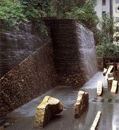 shunmyo masuno by shunmyo masuno, yokohama, japan, 1998  the regional japanese plants and tranquility of the waterfall, help give serenity to the garden outside the bustling hotel