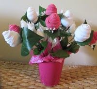 Can't wait to do this for some baby girl showers! Love the sock flower arrangement!
