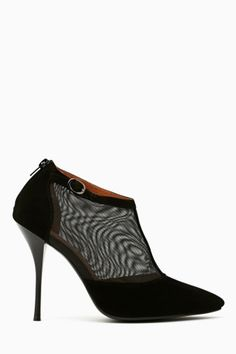 Ultra chic black suede booties featuring a pointed toe and sheer mesh detailing. Stiletto heel, buckled ankle strap. Zip closure at back, genuine leather lining. Looks killer with a tight dress and leather clutch! By Jeffrey Campbell.