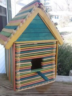 DIY birdhouse made from popsicle sticks and wood glue....great school project idea.