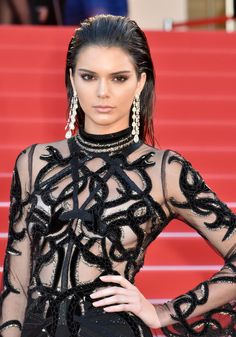 Kendall Jenner looked like a glimmering goddess at the premiere of From the Land and the Moon thanks to her glossy, wet-look hair and strobed features.