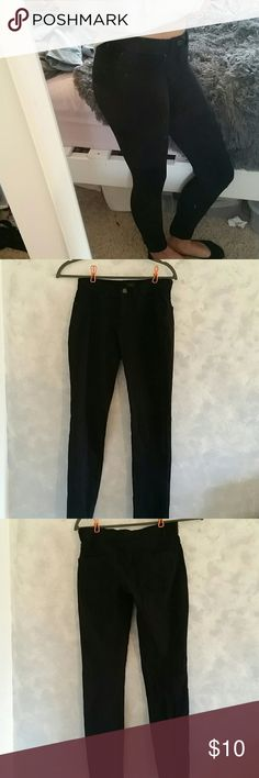 "Stretchy Black Pants Super stretchy black legging/pants. Has back pockets. Low rise waist. Good condition, one small tear on the knee (shown to the left of the quarter in the image provided). Size small or 3-5. There is another pair of similar pants that I have for sale, so check out my closet to see if those would work better for you!  Measurements: Waist: 13"" Inseam: 26"" Rise: 7.5""  Feel free to comment any questions! Offers considered and packages sent ASAP. Happy poshing :) labijou Pants…"