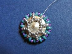 Now that my knitting fever is over, I am back to beading. After two month hiatus, I showed up at the door of the local bead store and w...