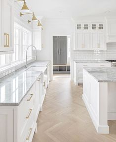 Light wood floors, white cabinets & grey laundry room to accent