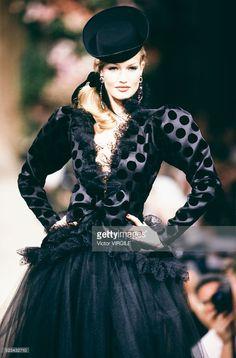 Karen Mulder walks the runway at the Yves Saint Laurent Haute Couture Fall/Winter 1992