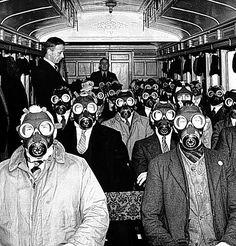 Under threat: Wartime train passengers in their gas masks