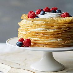 Vanilla Bean Crepe Cake: This stack of golden crepes and creamy mascarpone is simple, elegant and deceptively delicious. Recipe: http://www.midwestliving.com/recipe/vanilla-bean-crepe-cake/