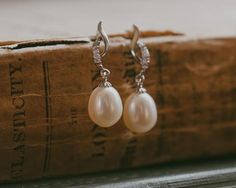 With a beautiful and delicate setting of tiny crystals and Sterling Silver, the Bolero earrings are very special occasion wear. Pearl Earrings Wedding, Pearl Drop Earrings, Bridal Earrings, Pearl Jewelry, Wedding Jewelry, Wedding Hair, Wedding Dresses, Swarovski, Jewelry Center