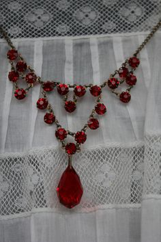 Circa 1920s / 1930s Art Deco Red Drop or Dangle Crystal Lavaliere Necklace in Waterfall Design. $64.00, via Etsy.
