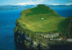 "I've learned the following from commenters about this wonderful place:    Iwona Siwon:  ""island of Elliðaey near Vestmannaeyjar, a small archipelag off the south coast of Iceland :)""    Juliet Farrell:  ""It's Bjork's house."""