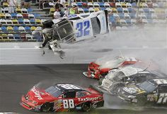 Kyle Larson (32) goes airborne and into the catch fence in a multi-car crash involving Dale Earnhardt Jr. (88), Parker Kligerman (77), Justi...