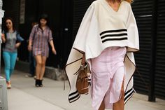 The NYFW Street-Style Looks That Truly Stunned #refinery29  http://www.refinery29.com/2014/09/73987/new-york-fashion-week-2014-street-style-photos#slide54  An Altuzarra poncho look that's chic, not shlubby.  Altuzarra poncho Spring 2014.