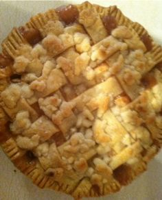 Double crust apple pie with crumbles on top